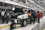 Workers on the production line at the Nissan Plant in Canton Mississippi work on assempling the new Pathfinder Armada Thursday August 7, 2003.(photo/Suzi Altman)