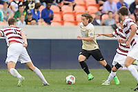 Houston, TX - Friday December 11, 2016: Hayden Partain (21) of the Wake Forest Demon Deacons brings the ball up the field against the Stanford Cardinal at the NCAA Men's Soccer Finals at BBVA Compass Stadium in Houston Texas.