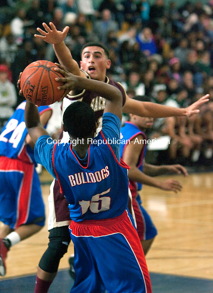 WATERBURY,  CT, 10 DECEMBER 2011-121011JS19-Sacred Hearts' Eddie Rivera (13) puts pressure on Crosby's Trevon Butler during their game in the boys city basketball jamboree Saturday at Kennedy High School. <br />