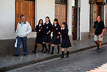 South America, Peru, Cusco. Uniformed school girls on the street in Cusco.