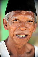 66 year old Pak Selamat, of Besuki village, one of thousands displaced by the Lapindo Mud Flow. Since May 2006, more than 10,000 people in the Porong subdistrict of Sidoarjo have been displaced by hot mud flowing from a natural gas well that was being drilled by the oil company Lapindo Brantas. The torrent of mud - up to 125,000 cubic metres per day - continued to flow three years later.