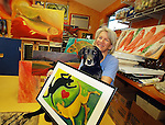 Photo by Phil Grout..South Carroll artist Melinda Byrd is known for her whimsical images.of fish and dogs.  Melinda draws some of her inspiration from.her &quot;Lab Assistant&quot;, &quot;Hooper&quot;--a black lab who is also a fine lap dog..Melinda will be displaying this work, &quot;Yin Yang Labs&quot;, along with.other paintings, prints and tee shirts at the Carroll County Arts Council's.&quot;Art in the Park&quot; this Saturday behind City Hall.
