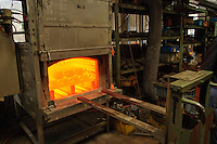 """Heating iron kettles to produce a rust proof surface, Oigen """"Nambu Tekki"""" ironware foundry, Esashi, Iwate Prefecture, Japan, August 28 2008."""