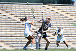 03 April 2016: Notre Dame's Barbara Sullivan (17) and North Carolina's Sammy Jo Tracy (left) challenge for a draw. The University of North Carolina Tar Heels hosted the University of Notre Dame Fighting Irish in a 2016 NCAA Division I Women's Lacrosse match. Maryland won the game 14-8.