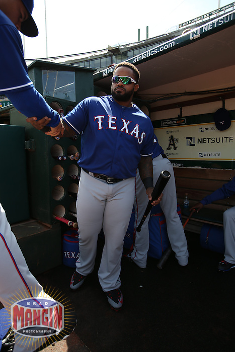 OAKLAND, CA - APRIL 9:  Prince Fielder #84 of the Texas Rangers stands in the dugout before the game against the Oakland Athletics at O.co Coliseum on Thursday, April 9, 2015 in Oakland, California. Photo by Brad Mangin