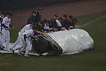 Ole Miss players roll out the tarp in the second inning at Oxford University Stadium in Oxford, Miss. on Wednesday, February 23, 2011.