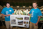 Benjamin Bruno, left and  Stephen Bartone, right display their mechanical solution to cover winter crops.