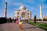 Agra, India, January 1975: A kid in front of the Taj Mahal located in Agra, India. Taj Mahal is a white marble mausoleum built by Mughal emperor Shah Jahan in memory of his third wife, Mumtaz Mahal. Taj Mahal is the finest example of Mughal architecture, a style that combines elements from Persian, Turkish and Indian architectural styles and also considered as one of the seven wonders of the world. In 1983, the Taj Mahal became a UNESCO World Heritage Site.