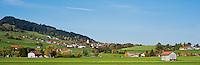 Village of Rettenberg with surrounding hillside and farmland, Allgäu, Bavaria, Germany