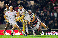 Phil Dollman of Exeter Chiefs looks to offload the ball after being tackled by Maxime Mermoz of Leicester Tigers. Aviva Premiership match, between Leicester Tigers and Exeter Chiefs on March 3, 2017 at Welford Road in Leicester, England. Photo by: Patrick Khachfe / JMP