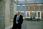 GERRY FITT OUTSIDE THE HOUSE WHERE HE WAS BORN, Sir Gerry Fitt, founder of the SLDP and MP for West Belfast. Body guard by car.
