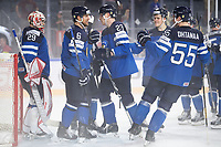 dpatop - Finland's goalkepper Harri Sateri (left to right), Topi Jaakola, Joonas Kemppainen and Atte Ohtamaa celebrate after the Ice Hockey World Championship quarter-final match between the US and Finland in the Lanxess Arena in Cologne, Germany, 18 May 2017. Photo: Marius Becker/dpa /MediaPunch ***FOR USA ONLY***