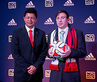 #20 overall pick Thomas McNamara of Chivas USA stands with head coach Wilmer Cabrera during the MLS SuperDraft at the Pennsylvania Convention Center in Philadelphia, PA, on January 16, 2014.