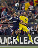 New England Revolution midfielder Ryan Guy (13) and Columbus Crew midfielder Dilly Duka (11) battle for head ball.  In a Major League Soccer (MLS) match, the Columbus Crew defeated the New England Revolution, 3-0, at Gillette Stadium on October 15, 2011.