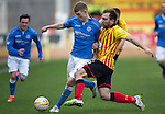 Partick Thistle v St Johnstone.....14.03.15<br /> David Wotherspoon is tackled by Conrad Balatoni<br /> Picture by Graeme Hart.<br /> Copyright Perthshire Picture Agency<br /> Tel: 01738 623350  Mobile: 07990 594431