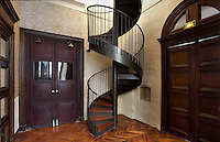 Spiral staircase connecting ground floor to the Salle des Pelerins at the first floor, 2012 by Jacques Metailie, Basilique Notre-Dame-des-Victoires (Basilica Notre-Dame-des-Victoires), founded in 1629 by King Louis XIII and finalized in 1737 by Sylvain Cartaud, 2nd arrondissement, Paris, France. Picture by Manuel Cohen