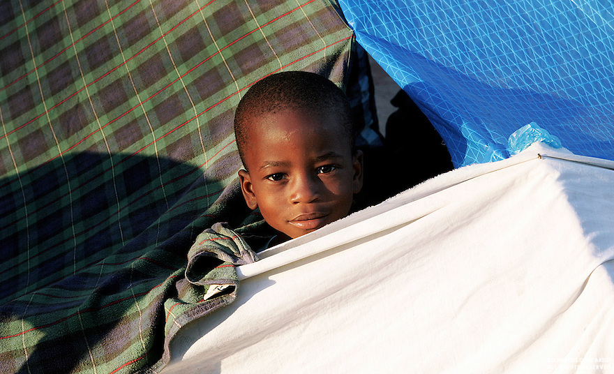 1/24/10 - Port au Prince - Haiti - One of thousands of homeless children that now live in improvised refugee camps all over the city after the deadly earthquake that devastated Port au Prince & killed thousands on January 12,2010. (Jose Jimenez-Tirado/Auxiliaris Haiti)