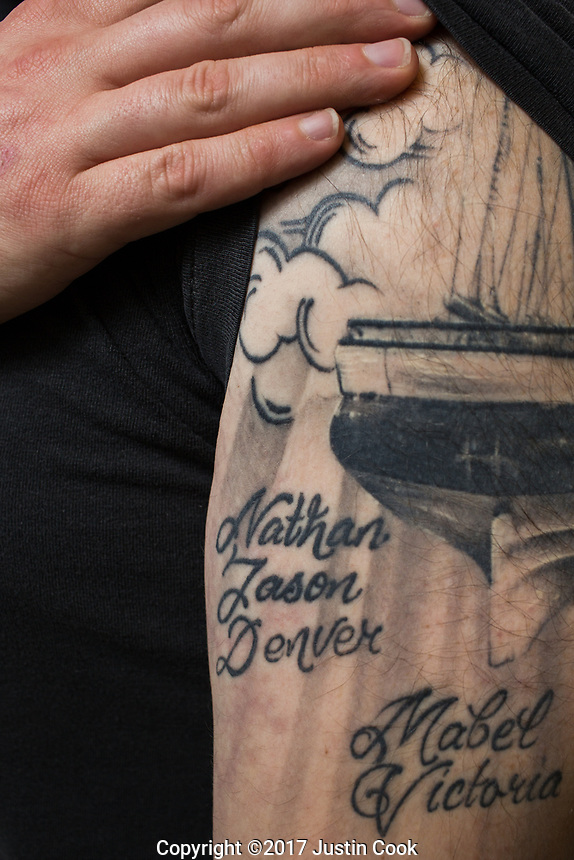 Colin Miller shows a tattoo of friends he's lost to addiction -- Nathan, Jason and Denver. A recovering addict, he helps run the Twin City Harm Reduction Collective, a needle exchange for addicts, at Green Street Church in Winston-Salem, NC.