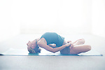 Beautiful yoga photography with woman in studio