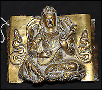 BNPS.co.uk (01202 558833)<br /> Pic: HAldridge/BNPS<br /> <br /> The repousse Tibetan gilt copper deity that were left at home.<br /> <br /> A man who took an old silver teapot along to TV's Flog It is celebrating today after it led to a record 140,000 pounds sale.<br /> <br /> Experts on the BBC show valued the item, that originated from the Far East, at 120 pounds, prompting the owner to reveal he had five other heirlooms at home.<br /> <br /> After digging the relics out he sold them at auction for the six figure sum, setting a record for the highest amount ever achieved on the popular programme.<br /> <br /> The show is very much like the Antiques Roadshow except that people go on to sell their treasures at auction which is also filmed by the Beeb.<br /> <br /> The unnamed owner took the 12ins tall teapot along to a valuation day held last month at Longleat House, Wilts.