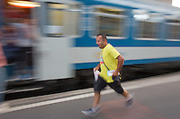 Illegal migrant man rushes to get on their train to travel to Germany at the main railway station Keleti in Budapest, Hungary on August 31, 2015. ATTILA VOLGYI