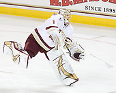 John Muse (BC - 1) sends the puck up ice.  Muse made 32 saves for the shutout. - The Boston College Eagles defeated the visiting University of Maine Black Bears 4-0 on Friday, November 19, 2010, at Conte Forum in Chestnut Hill, Massachusetts.