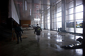 New York, New York.October 30, 2012..Workers enter a building in lower Manhattan damaged by water from Hurricane Sandy.
