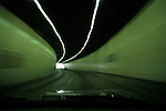Rush hour traffic looking through windshield at cars in tunnel with light streaks Seattle Washington State USA