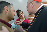 Cardinal Timothy Dolan, the archbishop of New York and chair of the Catholic Near East Welfare Association, blesses a child in the Mar Narsai Clinic in Dahuk, Iraq, on April 10, 2016. The clinic was built and equipped by CNEWA to meet the needs of Christians and others displaced to Dahuk because of attacks by ISIS.<br /> <br /> Cardinal Dolan came to Iraqi Kurdistan with Bishop William Murphy of Rockville Centre and other church leaders to visit with Christians and others affected by ISIS. <br /> <br /> CNEWA is a papal agency providing humanitarian and pastoral support to the church and people in the region.