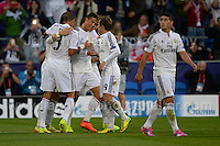 Cardiff City Stadium, Cardiff, South Wales - Tuesday 12th Aug 2014 - UEFA Super Cup Final - Real Madrid v Sevilla - <br /> <br /> Real Madrid&rsquo;s Christiano Ronaldo(c) is joined in celebration by his team mates after he scored his sides first goal of the game. <br /> <br /> <br /> <br /> <br /> Photo by Jeff Thomas/Jeff Thomas Photography