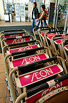 Customers exit an Aeon supermarket in western Tokyo, Japan. AEON CO. owns or franchises over 5,000 stores worldwide and is Japan's largest supermarket chain. AEON also runs a number of specialty chains, including The Body Shop and Laura Ashley stores in Japan.