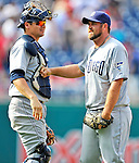 29 May 2011: San Diego Padres pitcher Heath Bell celebrates closing out the game with catcher Rob Johnson after a game against the Washington Nationals at Nationals Park in Washington, District of Columbia. The Padres defeated the Nationals 5-4 to take the rubber match of their 3-game series. Mandatory Credit: Ed Wolfstein Photo