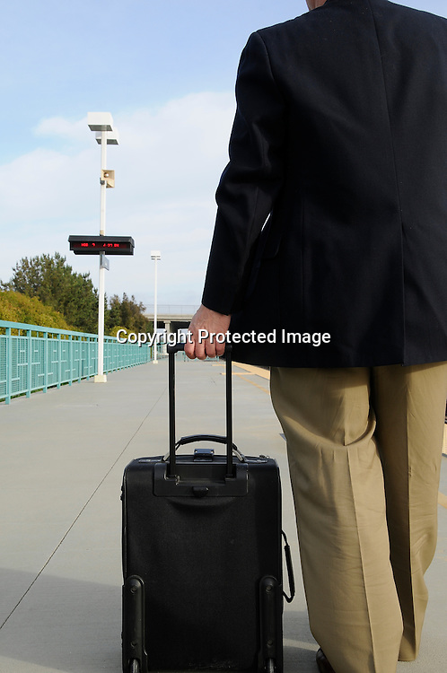 Businessman Waiting For Train