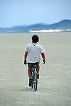 Man cruising accross the playa in the Black Rock Desert at 25mph.