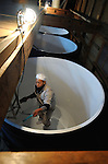 (FILE) A brewery staff hand cleans out 5,000-liter tanks used in brewing process of sake, a wine-like beverage fermented from rice, water, yeast and a starch-killing mold called koji-kin, at a sake brewery in Kyoto, Japan. more than 1,200 sake breweries exist in Japan, though falling domestic consumption has lead some to look to overseas markets...Photographer: Robert Gilhooly