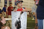 Landon Bridges shows off the autographs he collected during Ole Miss' Meet The Rebels in Oxford, Miss. on Saturday, August 18, 2012.