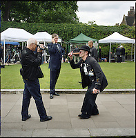 UK. London. From a story on Abingdon Street Gardens, a small patch of land, often referred to as College Green, that lies next to The Houses of Parliament in Westminster. It is a place where the media and the politicians come face to face. Interviews are held, photo shoots are set up and bewildered tourists stroll by..Photo shows publicity for a party on the day Gordon Brown took over as Prime Minister..Photo©Steve Forrest/Workers Photos