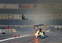Feb 9, 2014; Pomona, CA, USA; NHRA top fuel dragster driver Sidnei Frigo blows a tire after he explodes an engine during the Winternationals at Auto Club Raceway at Pomona. Mandatory Credit: Mark J. Rebilas-