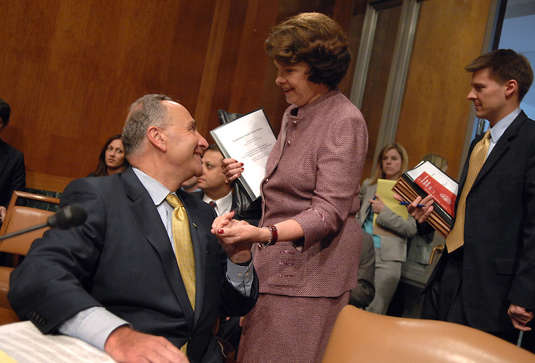 "Sen. Charles Schumer, D-N.Y., talks with Dianne Feinstein, D-Calif., before a Senate Judiciary Committee hearing entitled ""Preserving Prosecutorial Independence: Is the Department of Justice Politicizing the Hiring and Firing of U.S. Attorneys? - Part V."""