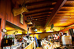 Jocko's Steak House in Nipomo, CA. The bar which features brands of local cattle ranches burned into the wood underneath the taxidermy deer heads