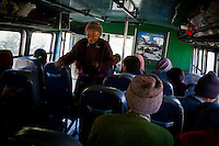 Ladakhi locals board the bus on 3rd June 2009 on the way to Leh from Hemis and Ulley Valley. The valley of Ladakh is located in the Indian Himalayas, in the northern state of Jammu and Kashmir. Photo by Suzanne Lee