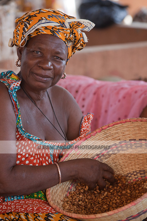 In the town of Djibo in northern Burkina Faso, a woman sells peanuts in the market.