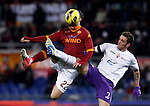 Calcio, Serie A: Roma vs Fiorentina. Roma, stadio Olimpico, 8 dicembre 2012..AS Roma forward Mattia Destro is challenged by Fiorentina defender Gonzalo Rodriguez, of Argentina, right, during the Italian Serie A football match between AS Roma and Fiorentina at Rome's Olympic stadium, 8 december 2012..UPDATE IMAGES PRESS/Isabella Bonotto