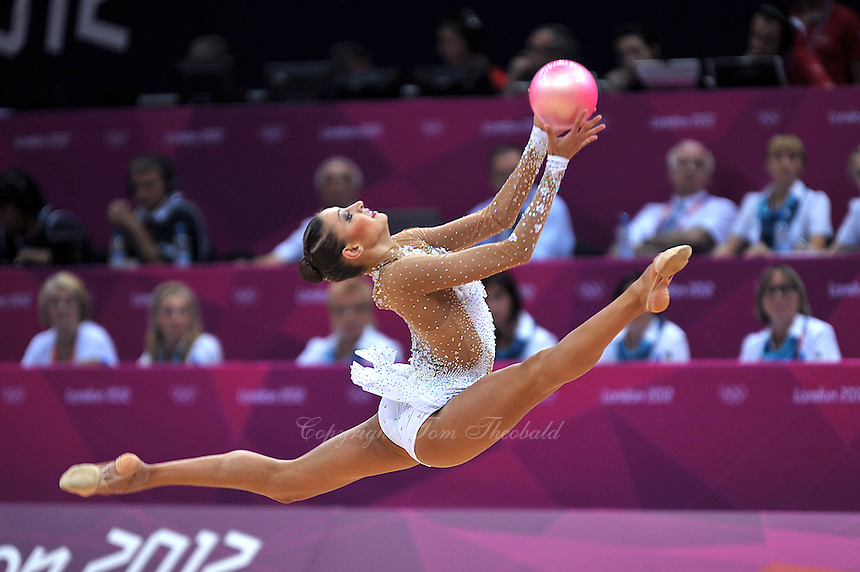 August 11, 2012; London, Great Britain;  EVGENIYA KANAEVA of Russia split leaps to rematch ball during All-Around final at London 2012 Olympics.