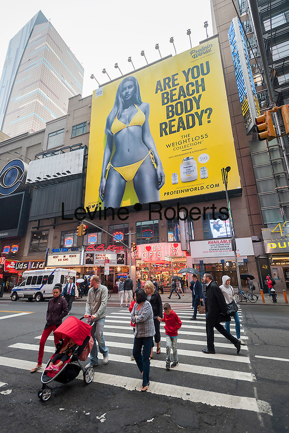"A billboard for Protein World asking whether you are ""beach body ready"" in Times Square in New York on Monday, June 1, 2015. The advertising featuring model Renee Somerfield elicited controversy when they appeared in the UK where they were accused of fat-shaming and perpetuating an unrealistic body type. The ads are also scheduled to appear in New York subways.   (© Richard B. Levine)"