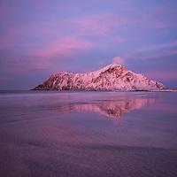 Hustind mountain peak glows pink over Skagsanden beach, Flakstad, Flakstadøy, Lofoten Islands, Norway