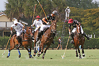 WELLINGTON, FL - APRIL 15:  Agustin Obregon of Palm Beach Illustrated (dark jersey, maroon helmet) controls the ball as teammate Jared Zenni looks on, in the $100,000 World Cup Final, at the Grand Champions Polo Club, on April 15, 2017 in Wellington, Florida. (Photo by Liz Lamont/Eclipse Sportswire/Getty Images)