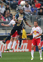 CHESTER, PA - OCTOBER 27, 2012:  Michael Lahoud (13) of the Philadelphia Unionbeats   Dax McCarty (11) of the New York Red Bulls to a header during an MLS match at PPL Park in Chester, PA. on October 27. Red Bulls won 3-0.