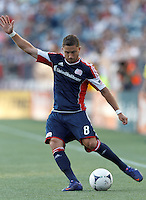 New England Revolution defender Chris Tierney (8) crosses the ball. In a Major League Soccer (MLS) match, New England Revolution defeated New York Red Bulls, 2-0, at Gillette Stadium on July 8, 2012.