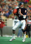 CHICAGO,IL-1985:  NFL quarterback Jim McMahon of the Chicago Bears drops back to pass during an NFL game at Soldier Field in Chicago Illinois.  McMahon played for the Chicago Bears from 1982-1988.  (Photo by Ron Vesely)